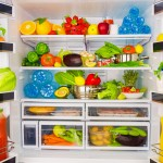 Open fridge full of fresh fruits and vegetables, healthy food